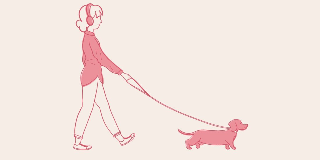 Girl walking her dog while listening to creative podcasts