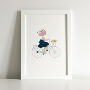 Illustrated print of a girl riding a bicycle and having a happy time.